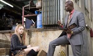 Dakota Fanning and Djimon Hounsou in Push