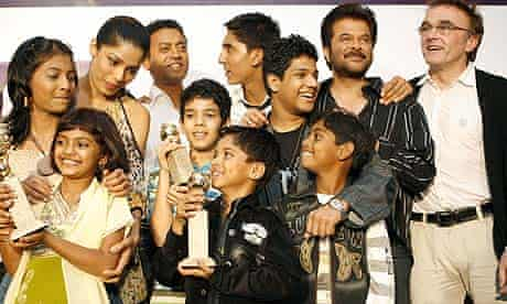 Danny Boyle with some of the cast of Slumdog Millionaire in Mumbai