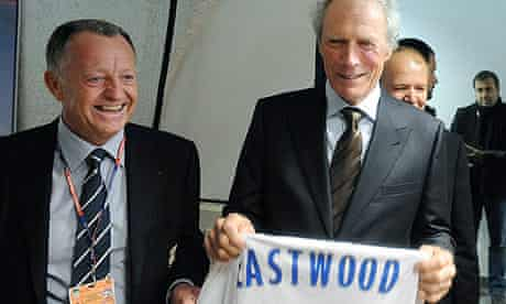 Clint Eastwood with his Olympique Lyonnais shirt and club president Jean-Michel Aulas