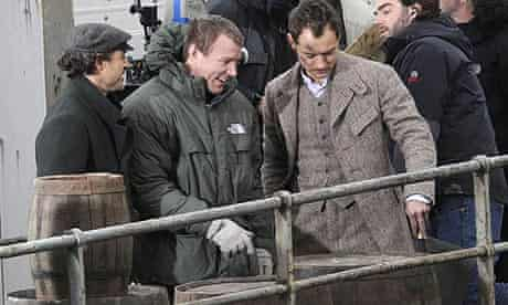 Guy Ritchie with Robert Downey Jr and Jude Law on the set of Sherlock Holmes
