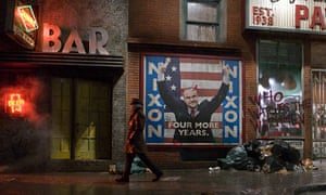 Rorschach from the Watchmen walking past a poster of Richard Nixon