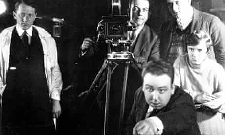 Alfred Hitchcock on the set of The Mountain Eagle (1926), with his future wife Alma Reville behind