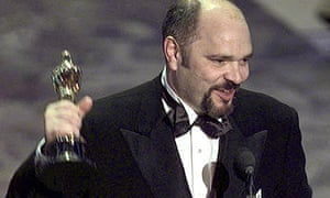 Anthony Minghella with his best director Oscar at the 1997 Academy Awards