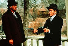 Terence Stamp and Emilio Estevez in Young Guns (1988)