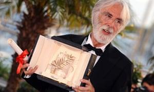Austrian director Michael Haneke poses with the Palme d'Or award