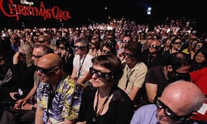 Cannes film festivalgoers wear 3D glasses to watch Disney's A Christmas Carol