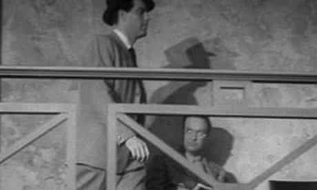 Raymond Chandler (sitting) in cameo in Double Indemnity