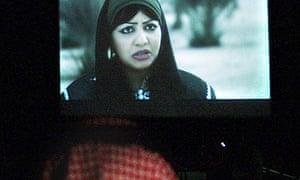 A Saudi man watches Menahi in Riyadh on 6 June 2009