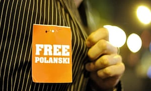 A man wears a 'Free Polanski' sign on his shirt at the Zurich film festival
