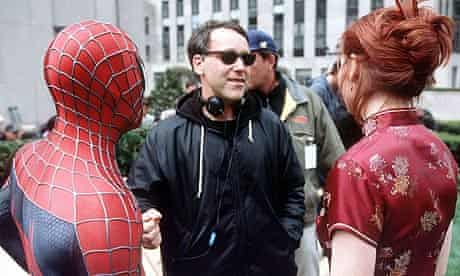 Sam Raimi on the set of Spider-Man with Tobey Maguire and Kirsten Dunst