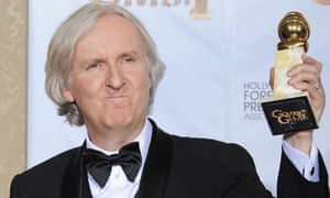 James Cameron poses with Avatar's award for best motion picture (drama) at the Golden Globes