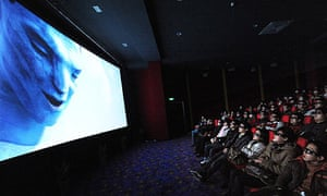Chinese moviegoers watch Avatar in a cinema in Hefei, in Anhui province