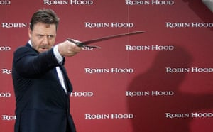 Russell Crowe poses with a sword at a Robin Hood photocall in Madrid