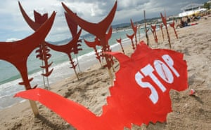 Cannes film festival day6: Greenpeace protest on beach at Cannes film festival