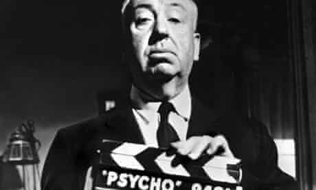 Alfred Hitchcock with the Psycho clapperboard