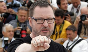 Lars Von Trier shows his tattoo during the photocall of Melancholia