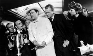 Orson Welles (centre) in his 1941 film Citizen Kane, which he also wrote and directed.