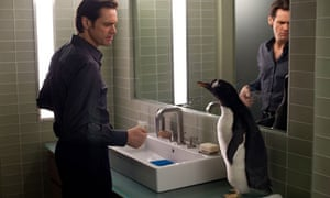 Jim Carrey flicks water at a penguin in Mr Popper's Penguins