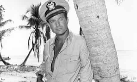 Cliff Robertson as JFK leaning nonchalantly against a palm tree