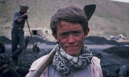 The Boy Mir: Ten Years in Afghanistan: Mir in 2009 holding pick in coal pit