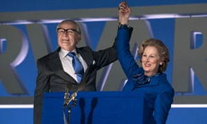 Meryl Streep and Jim Broadbent as Margaret and Denis Thatcher hold hands aloft in victory