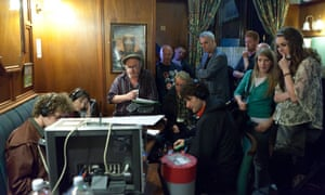 Niall Griffiths and the Kelly+Victor cast in a pub room with film equipment
