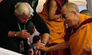 U.S. actor Gere greets Dalai Lama on the fourth day of Kalachakra festival in Bodhgaya