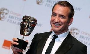 Jean Dujardin holds his best actor Bafta award