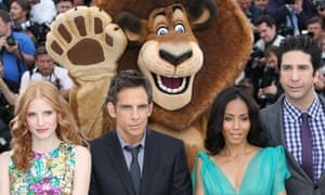 Jada Pinkett Smith with her co-stars and a lion at the Madagascar 3 photocall