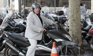 Acting up? … Gérard Depardieu on his scooter in Paris.