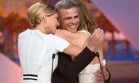 Lea Seydoux (left) and Adele Exarchopoulos embrace director Abdellatif Kechiche