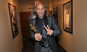 Making peace … 12 Years a Slave writer John Ridley with his best adapted screenplay Oscar.
