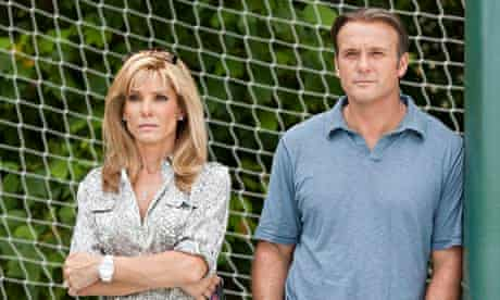 Sandra Bullock as Leigh Anne Tuohy and Tim McGraw as Sean Tuohy in The Blind Side.