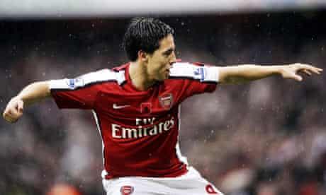 Samir Nasri celebrates scoring Arsenal's first goal against Manchester United.