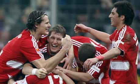 Bayern Munich players celebrate during the Bundesliga match against Vfl Bochum.