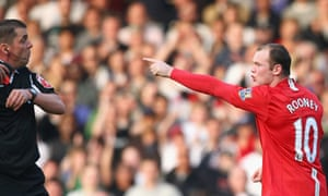 Wayne Rooney reacts to being shown the red card by Phil Dowd