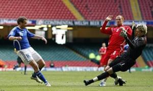 Finland's Jonatan Johansson puts the ball past Wales goalkeeper Wayne Hennessey