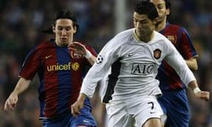 Cristiano Ronaldo and Lionel Messi challenge for possession