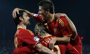Spain's David Villa and Albert Riera congratulate Fernando Torres