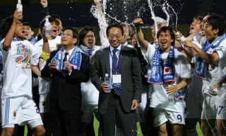 Japan players and coaches celebrate qualification for the 2010 World Cup