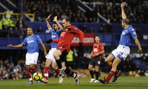 Wayne Rooney scores Manchester United's second goal as the Portsmouth defence appeal for offside