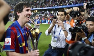 Lionel Messi celebrates Barcelona's victory in the Club World Cup in Abu Dhabi