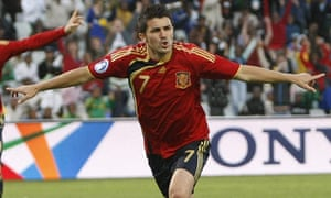 David Villa celebrates scoring for Spain during their Confederations Cup match against Iraq