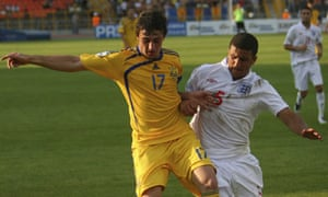 Ukraine's Vitaliy Kaverin and England's Kyle Walker fight for the ball