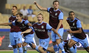 Aston Villa celebrate after winning the Peace Cup on a penalty shoot-out.