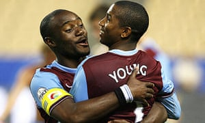 Nigel Reo Coker and Ashley Young