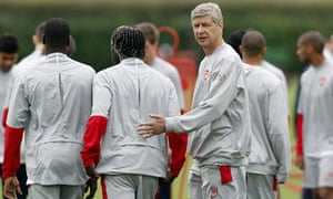 Arsène Wenger watches training ahead of his side's tie against Olympiako