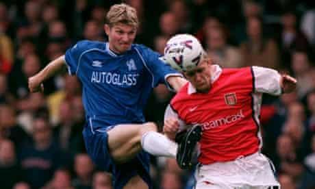 Chelsea's Tore Andre Flo battles with Arsenal's Emmanuel Petit
