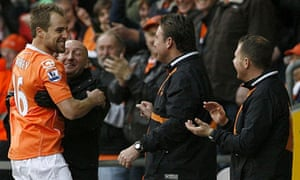 Luke Varney celebrates his wonder-striker with manager Ian Holloway and the Blackpool staff