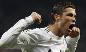 308c73b3863 Cristiano Ronaldo celebrates his goal against Lyon during their Champions  League last 16 match